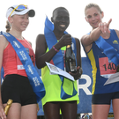 Girl power: Christina Bogomiakova, winner Caroline Kepchirchir and Northern Ireland's Laura Graham, the runner-up, are all smiles after the Belfast Marathon