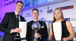 Winning feeling: Jonny Evans, Gavin Whyte and Lauren Perry with their NIFL awards last night