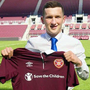 Done deal: Bobby Burns shows off his new Hearts shirt