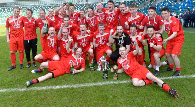 Winners alright: Enniskillen Rangers celebrate their Cup victory
