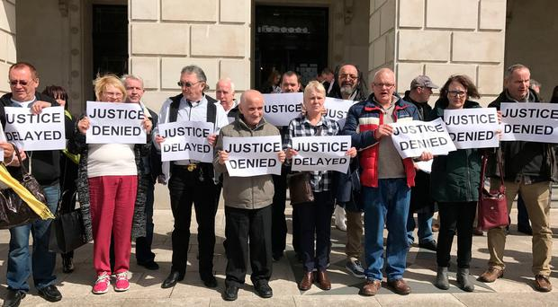 Victims of institutional child abuse protest at Stormont Castle in April 2017, after warring politicians failed to deliver a promised apology and financial redress. PA