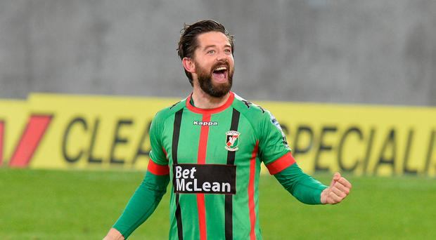 High drama: Glentoran's Curtis Allen celebrates his late winner against Linfield piling pressure on Linfield boss David Healy