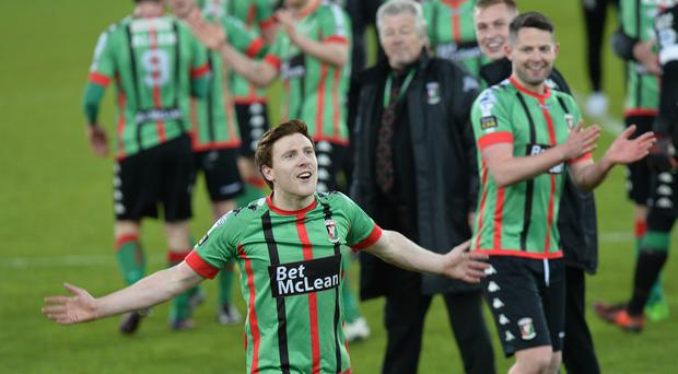 Glentoran's William Garrett celebrates after last night's game at Windsor park. Photo Colm Lenaghan/Pacemaker Press