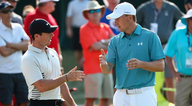 Big guns: Rory McIlroy (left) and Jordan Spieth chat on 12th yesterday
