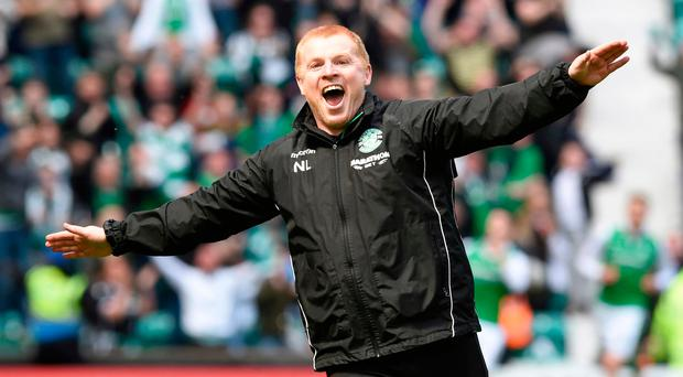 Flying high: Hibs boss Neil Lennon celebrates last gasp equaliser against Rangers