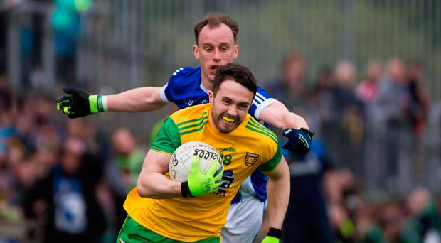 Tough battle: Donegal's Cian Mulligan (right) holds off Martin Reilly