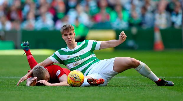 Celtic's Kristoffer Ajer battles for the ball