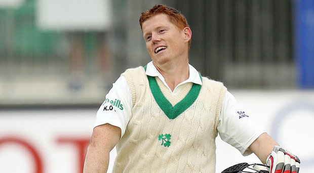 Special moment: Kevin O'Brien celebrates his century for Ireland yesterday