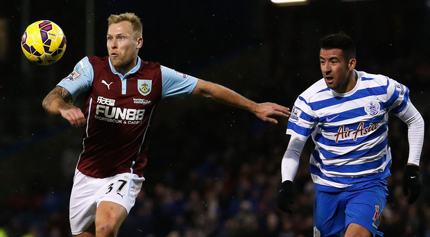 Arm's length: New Rangers ace Scott Arfield takes on Mauricio Isla of QPR. Photo: Getty Images