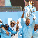Title lift: Vincent Kompany lifts the league crown