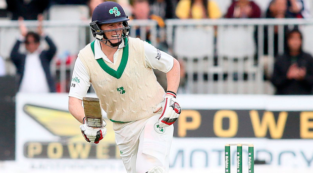 Made it: Kevin O'Brien of Ireland celebrates as he hits the runs to clock up his Test century yesterday