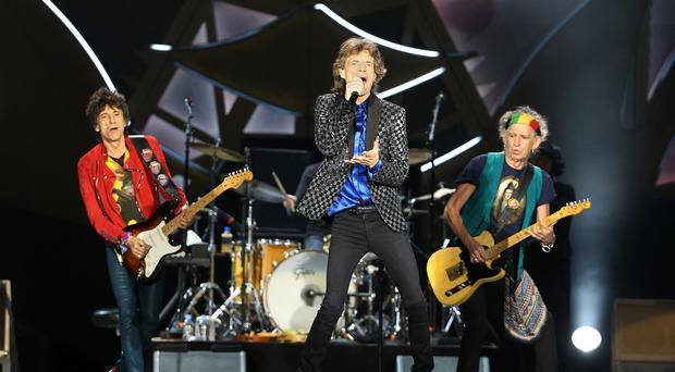 Ronnie Wood (L) Mick Jagger (C) and Keith Richards (R) on stage (Photo by Fiona Goodall/Getty Images)