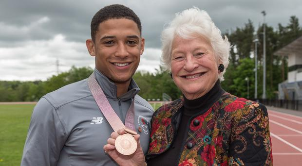 Glittering prize: Leon Reid shows his Commonwealth Games bronze to Olympic gold medallist Dame Mary Peters
