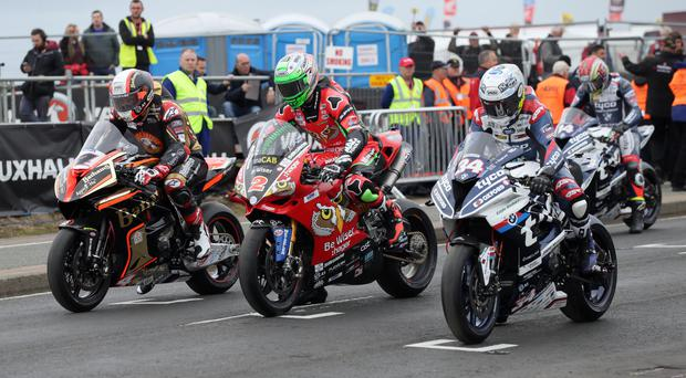 Revved up: Michael Rutter (Bathams BMW), Glenn Irwin (PBM Ducati) and Alastair Seeley on grid during first practice session
