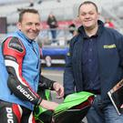 Blast from the past: Rider Liaison Officer Steve Plater (left) and BBC analyst Phillip McCallen, both former NW200 winners, during the opening practice session of the 2018 Vauxhall International North West