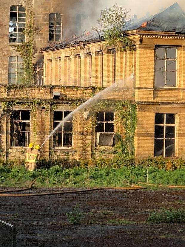 Firefighters tackle the blaze at the historic site.
