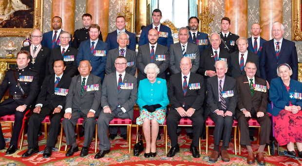 The Queen with Victoria and George Cross holders, including Brian Rea of the RUC George Cross Foundation (middle row, far right)