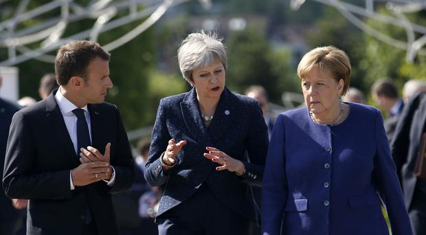 Theresa May with Angela Merkel and Emmanuel Macron at the EU Western Balkans summit in Sofia (Darko Vojinovic/AP)