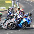 Crowd control: Michael Dunlop leads the pack into York Corner