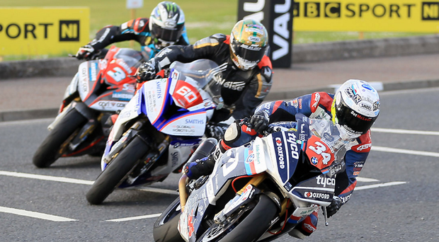 Lining up: Alastair Seeley (Tyco BMW) heads Peter Hickman (Smiths Racing BMW) and Michael Dunlop (Tyco BMW) during Thursday's Superstock race