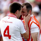 Getting heated: Ryan McMenamin (left), in his Tyrone playing days, has an exchange of views with Armagh's Stevie McDonnell