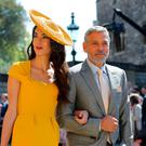 Amal Clooney and George Clooney arrive at St George's Chapel at Windsor Castle for the wedding of Meghan Markle and Prince Harry. Gareth Fuller/PA Wire
