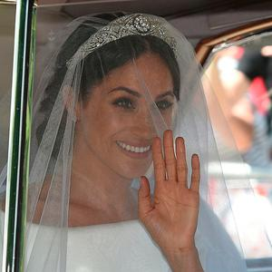 Meghan Markle arrives for her wedding ceremony to marry Britain's Prince Harry, Duke of Sussex, at St George's Chapel, Windsor Castle, in Windsor, on May 19, 2018. / AFP PHOTO / Oli SCARFFOLI SCARFF/AFP/Getty Images