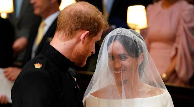 Britain's Prince Harry, Duke of Sussex (L) and US actress Meghan Markle (R) stand together at the altar in St George's Chapel, Windsor Castle, in Windsor, on May 19, 2018 during their wedding ceremony. / AFP PHOTO / POOL / Dominic LipinskiDOMINIC LIPINSKI/AFP/Getty Images
