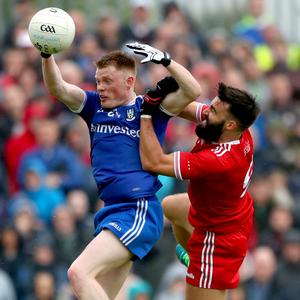 Reaching out: Monaghan's Ryan McAnespie is challenged by Tiernan McCann