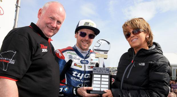 Victory Seel: three-time winner Alastair Seeley receives the Robert Dunlop North West 200 Man of the Meeting award from Robert's wife, Louise Dunlop and Event Director, Mervyn Whyte