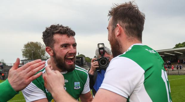 Winning smile: Fermanagh's James McMahon and Sean Quigley celebrate their well-earned victory over Armagh at Brewster Park