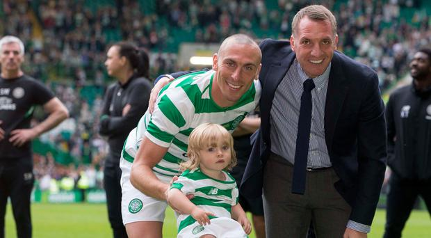 Winning smiles: Scott Brown with his son Kit and manager Brendan Rodgers at midfielder's testimonial match yesterday
