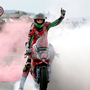 Smokin: Glenn Irwin's smoke grenade celebration after his double Superbike win