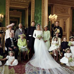 The Duke and Duchess in The Green Drawing Room, Windsor Castle, with (left-to-right): Back row: Master Jasper Dyer, the Duchess of Cornwall, the Prince of Wales, Ms. Doria Ragland, The Duke of Cambridge; middle row: Master Brian Mulroney, the Duke of Edinburgh, Queen Elizabeth II, the Duchess of Cambridge, Princess Charlotte, Prince George, Miss Rylan Litt, Master John Mulroney; Front row: Miss Ivy Mulroney, Miss Florence van Cutsem, Miss Zalie Warren, Miss Remi Litt. (Alexi Lubomirski/PA Wire)