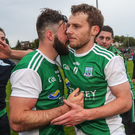 Job done: Fermanagh ace Declan McCusker celebrates with team-mate Kane Connor at Brewster Park
