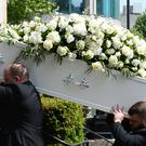 Dale Winton's coffin is carried into One Marylebone (Kirsty O'Connor/PA)