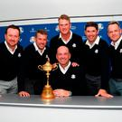 Star-studded cast: Graeme McDowell (left) with Ryder Cup captain Thomas Bjorn (seated) and the other vice-captains at Wentworth yesterday