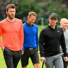 Rory McIlroy of Northern Ireland walks with former Manchester United stars Michael Carrick, Teddy Sheringham and Paul Scholes during the Pro Am at the BMW PGA Championship.