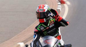 Honour: Johnny Rea at Black Hill during last week's tribute lap at the Vauxhall International North West 200 in Portrush