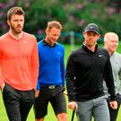 United front: Rory McIlroy walks the Wentworth course yesterday with Man United heroes Michael Carrick, Teddy Sheringham and Paul Scholes