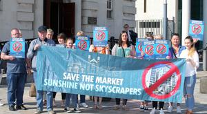 Residents of the Markets area of south Belfast pictured outside the High Court in Belfast.