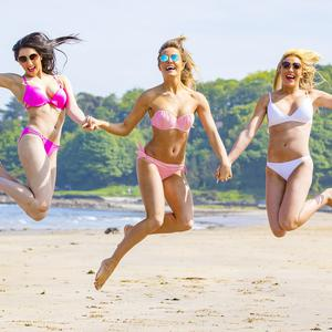 Insanity Tan Miss Northern Ireland finalists Lucy Spratt (White top / Pink stripe bikini), Nicole Beggs (Blue and white top / White Bikini) and Saha Boyle (Yellow top / Pink Bikini) enjoying the sunny weather at Helen's Bay ahead of the grand final organised by ACA Models taking place on Monday 28th of May at the Europa Hotel (Photo by Kevin Scott / Belfast Telegraph)