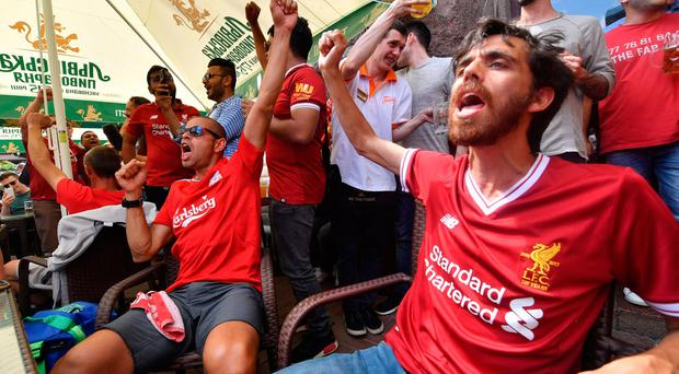 Liverpool FC fans cheer in a restaurant of central Kiev on May 25, 2018, on the eve of the 2018 UEFA Champions League final football match between Real Madrid and Liverpool FC. Pic Pa wires