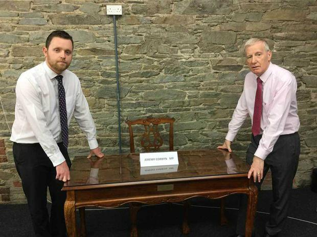 Gary Middleton MLA and Gregory Campbell MP with the empty chair where Mr Corbyn would have met victims.