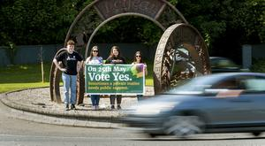 Campaigners for Yes stand at the Three Pennies Lifford roundabout (Liam McBurney/PA)