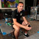 Key man: David Currie takes a deserved sit down in Panama surrounded by Northern Ireland's kit and equipment