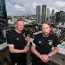 Austin MacPhee (right) will remain as Michael O'Neill's assistant coach in the NI set-up.
