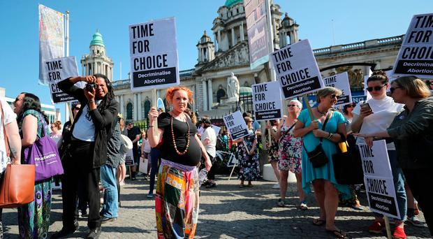 People attend a protest calling of for provision of abortion in Northern Ireland, at Belfast City Hall. PRESS ASSOCIATION Photo. Picture date: Monday May 28, 2018. Pic: Niall Carson/PA Wire