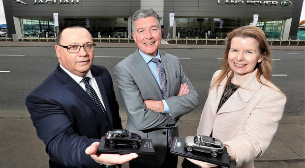 Outside the new Charles Hurst showroom are head of business Norman Fraser (left), operations director Colin McNab and Christina Fickling, regional business manager for Jaguar Land Rover