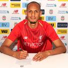 Done deal: Fabinho will join Liverpool in July